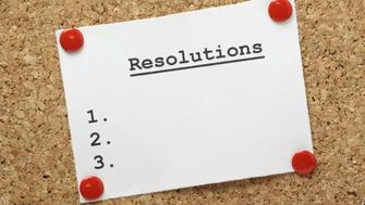 A blank list of resolutions for new year or in general pinned to a cork notice board with room for your text.