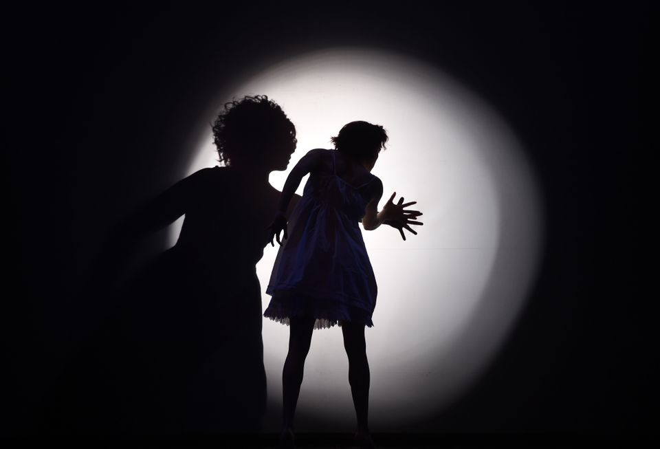 """Dancers with Pilobolus perform a scene during a dress rehearsal for the American premiere of Pilobolus' """"Shadowland"""" at NYU S"""