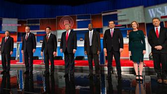 2016 Republican presidential candidates, from left, John Kasich, governor of Ohio, Jeb Bush, former Governor of Florida, Senator Marco Rubio, a Republican from Florida, Donald Trump, president and chief executive of Trump Organization Inc., Ben Carson, a retired neurosurgeon, Senator Ted Cruz, a Republican from Texas, Carly Fiorina, former chairman and chief executive officer of Hewlett-Packard Co., and Senator Rand Paul, a Republican from Kentucky, stand for a photograph at the start of a Republican presidential candidate debate in Milwaukee, Wisconsin, U.S., on Tuesday, Nov. 10, 2015. The fourth Republican debate, hosted by Fox Business Network and the Wall Street Journal, focuses on the economy with eight presidential candidates included in the main event and four in the undercard version. Photographer: Daniel Acker/Bloomberg via Getty Images