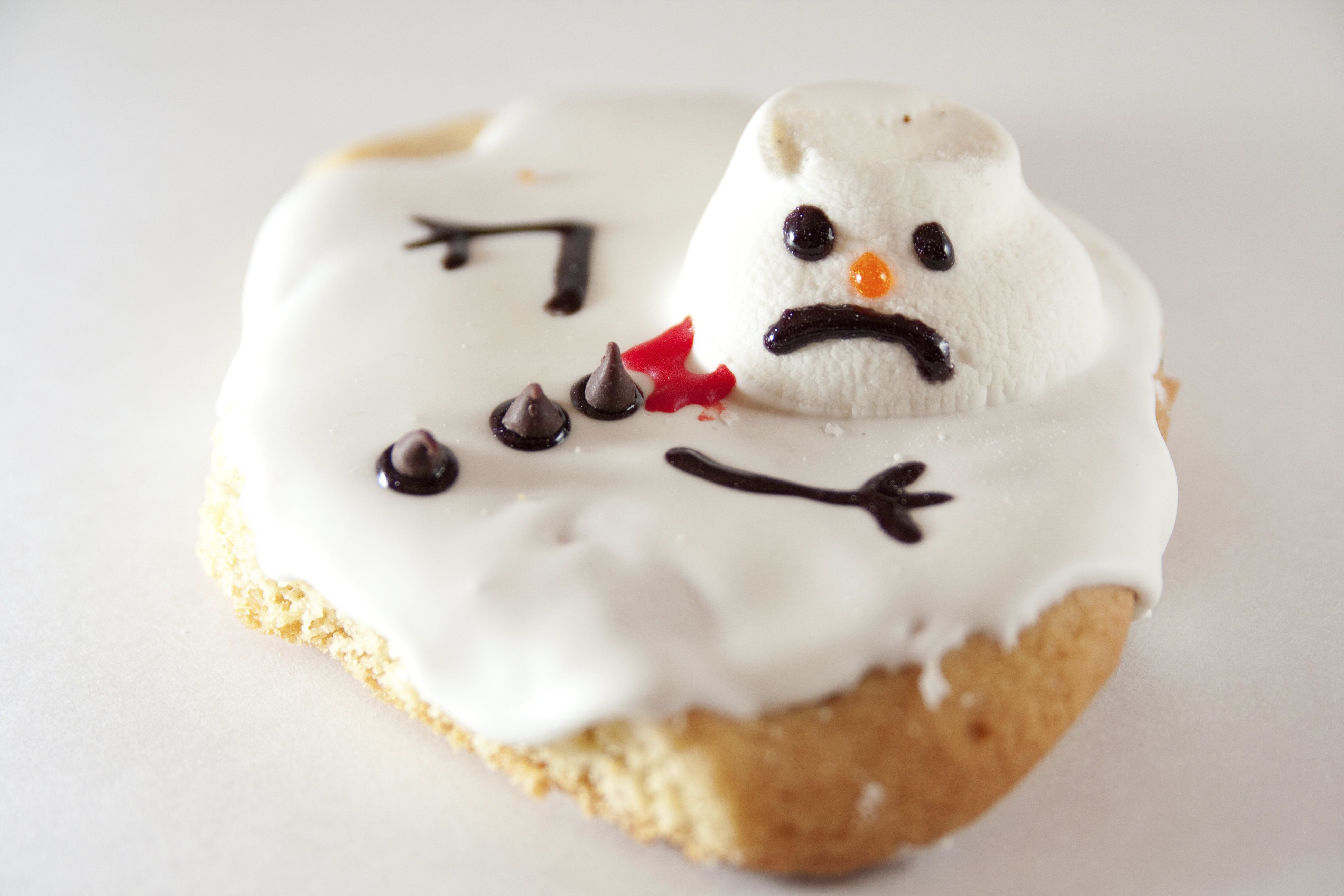 Melted Snowman Cookie on White Background