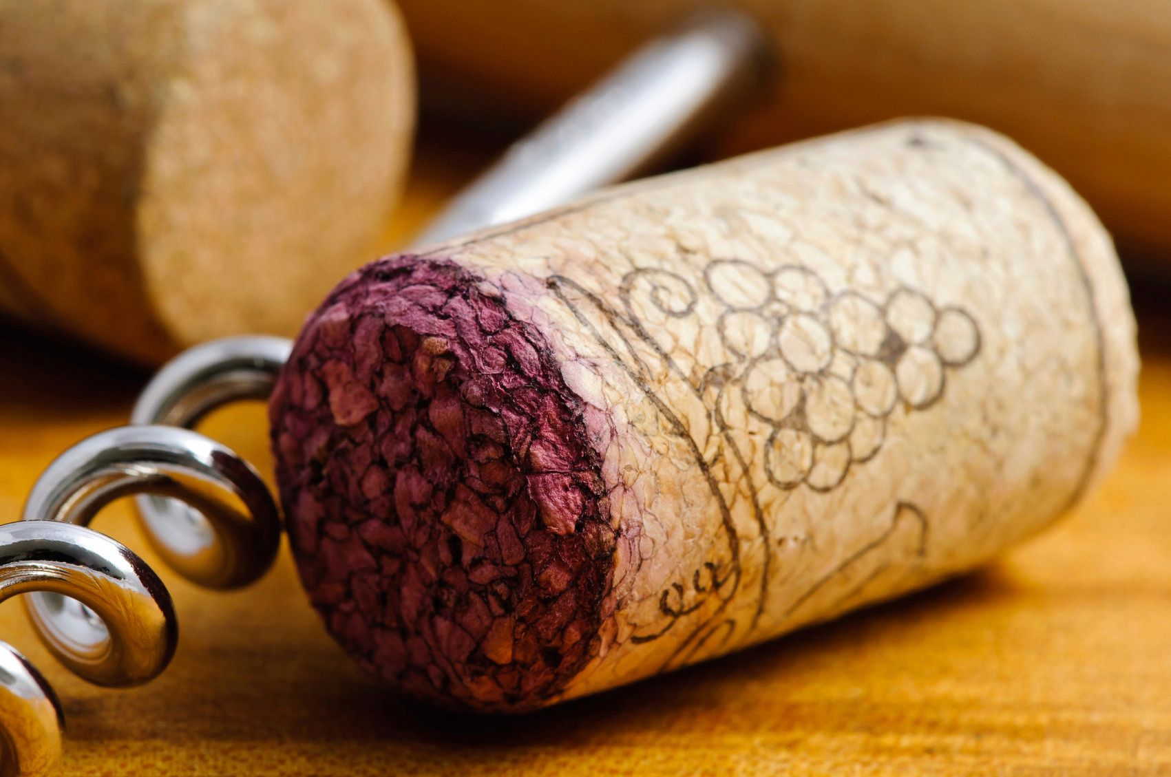 Closeup detail of wine cork and corkscrew