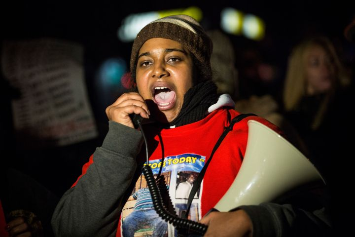 In December 2014, Erica Garner, daughter of Eric Garner, leads a march of people protesting the Staten Island, New York grand