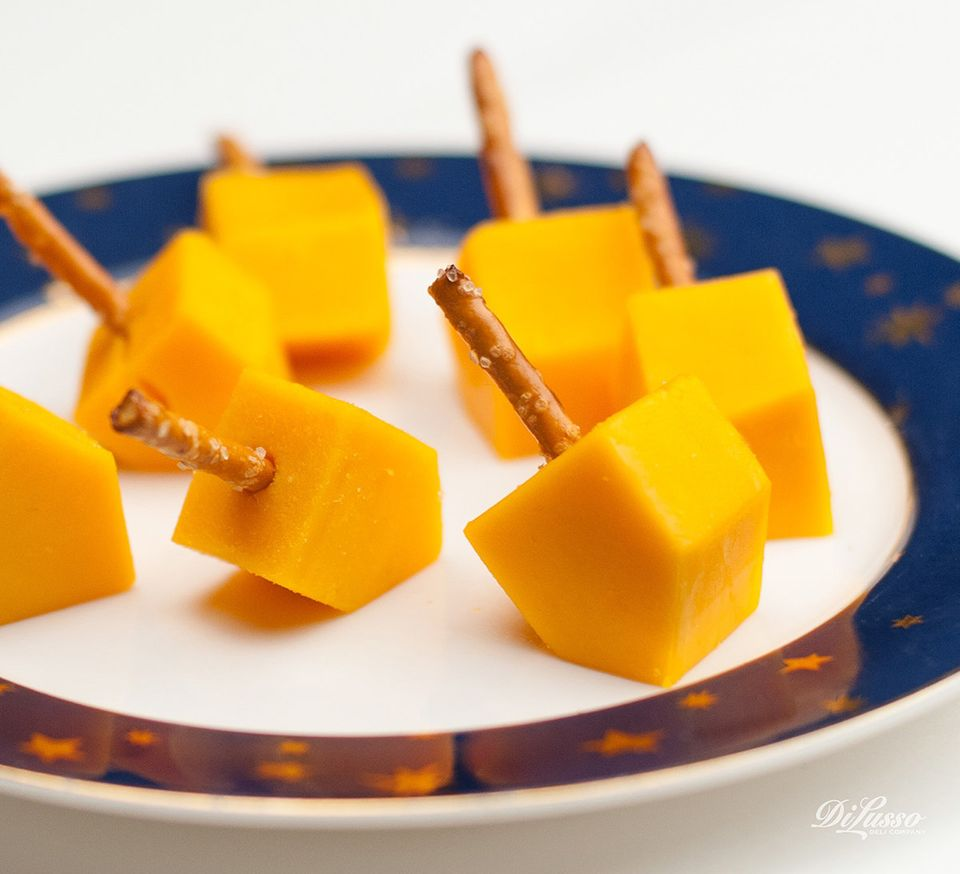 "This idea, <a href=""http://www.dilussodeli.com/features/cheese-dreidels"" target=""_blank"">from DiLusso Deli Company</a>, is si"