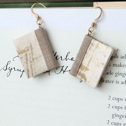 "Get the <a href=""https://www.etsy.com/listing/170887496/mini-book-earrings-gold-brushstrokes"">Mini Book Earrings</a>."