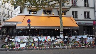 PARIS, FRANCE - DECEMBER 4: Flowers and notes are seen outside 'A La Bonne Biere', one of the cafes which were targeted in Paris terror attacks on November 13, after it reopened on Friday in Paris, France on December 4, 2015. (Photo by Mustafa Yalcin/Anadolu Agency/Getty Images)