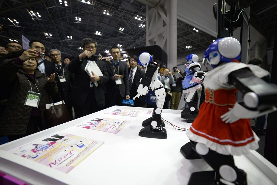 Small robots perform for exhibition attendees.