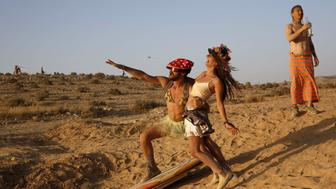 Israelis dance during the 2015 Midburn festival in the Negev Desert near the Israeli kibbutz of Sde Boker on May 23, 2015. Some 6000 Israelis and foreigners attended the five days of the Midburn festival, the Israeli version of the popular Burning Man festival held annually in the Black Rock Desert of Nevada. AFP PHOTO/GALI TIBBON == RESTRICTED TO EDITORIAL USE ==        (Photo credit should read GALI TIBBON/AFP/Getty Images)