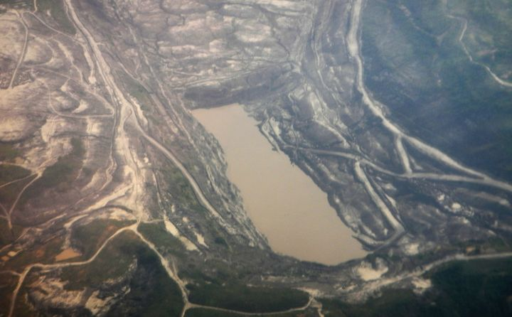 A November 2013 aerial view of coal mining in the Indonesian province ofEast Kalimantan, where a coal rush drewin