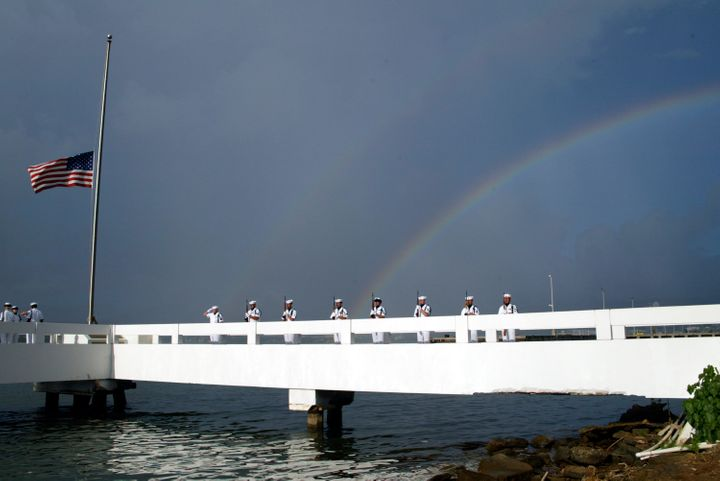 The Pearl Harbor Honor Guard presents arms at the burial at sea for Chief Yeoman Guy Pierce, who was aboard the USS Utah duri