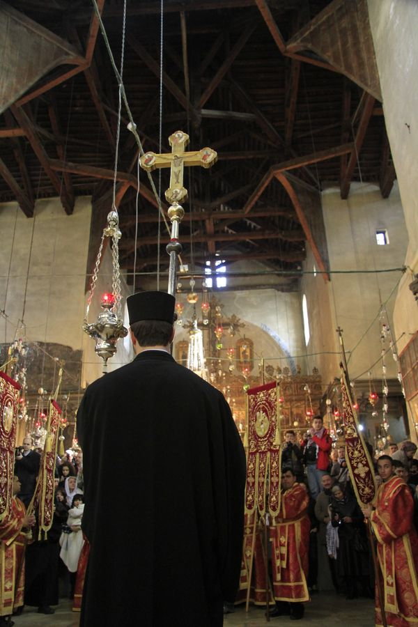Greek Orthodox ceremony in the Church of the Nativity in Bethlehem during Christmas.