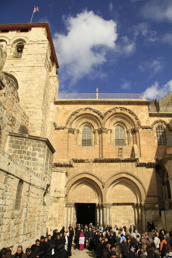 The Latin Patriarch of Jerusalem Fouad Twal departs from the Church of the Holy Sepulchre in Jerusalem on thefirst Sund