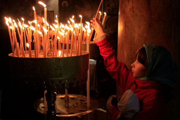 A young pilgrim at the Church of the Nativity in Bethlehem.