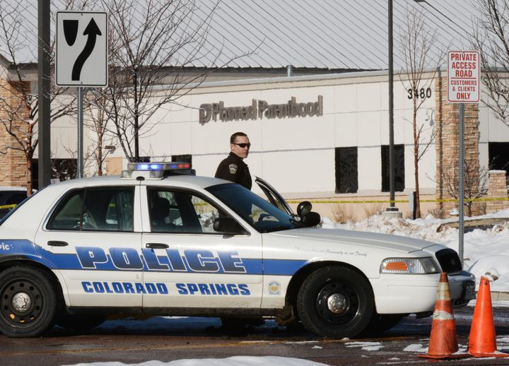 A Colorado Springs Police officer guards the entrance to the Planned Parenthood where a shooting occurred on Nov. 3