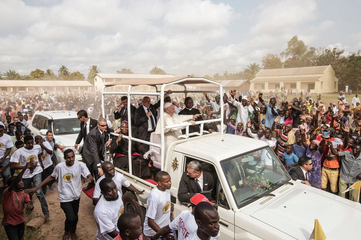 Pope Francis waves as he leavesthe Central Mosque in the PK5 neighborhood in Bangui.