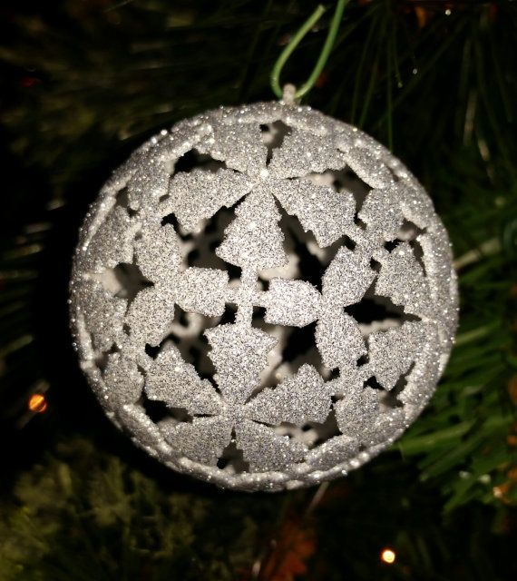 An InterfaithLiving Christmas ornament that featuresboth trees and dreidels.