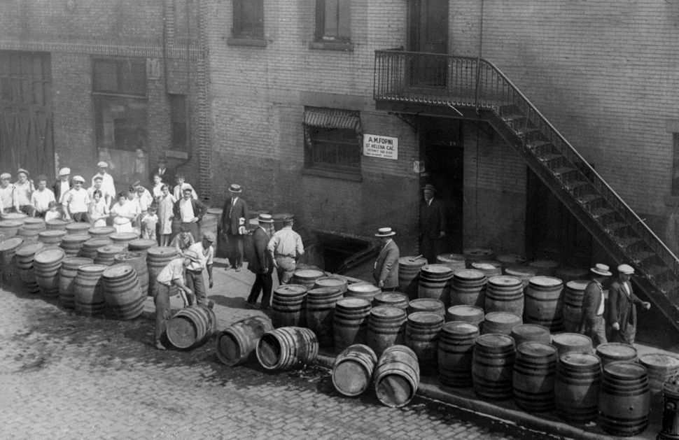 Children watch Prohibition agents and police officers destroy barrels of wine that have soured after being stored six years s