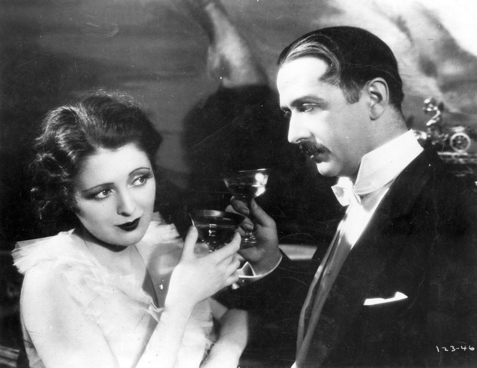 American actress Billie Dove in 1927 drinking champagne in a scene from the film 'American Beauty', directed by Richard Walla