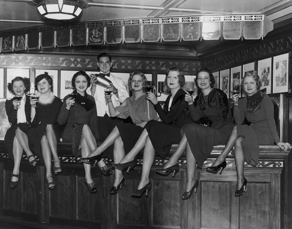 A group of young women at the bar on board the luxury liner SS Manhattan, off New York, 5th December 1933. Before the repeal