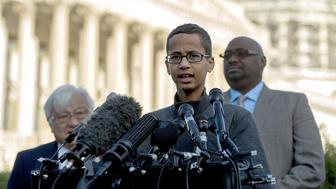Ahmed Mohamed (R), a 14-year-old high school student who was arrested after he brought a homemade clock to his Irving, Texas high school to show his teachers and was later accused of having a 'hoax bomb', speaks during a press conference on Capitol Hill in Washington, DC, October 20, 2015. Ahmeds detention played into national debates about Islam, immigration and ethnicity. Ahmed visited the White House Monday evening following a personal invitation from President Barack Obama. Ahmed, 14, attended the White House's Astronomy Night, along with other students, teachers, scientists and astronauts.  AFP PHOTO/JIM WATSON        (Photo credit should read JIM WATSON/AFP/Getty Images)