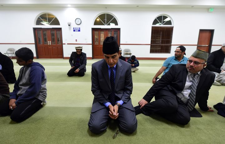 Members of the Ahmadiyya Muslim Community pray at the Baitul Hameed Mosque in Chino, California on December 3, 2015, where pe