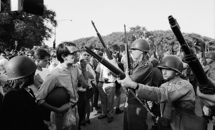 Protesters face off with armed National Guardsmen during the Democratic National Convention in Chicago in August 1968.