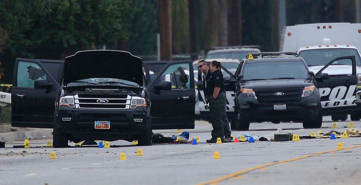 Crime Scene Investigators search the suspected assailants' SUV on San Bernardino Ave. December 4, 2015 in San Bernardino, Cal