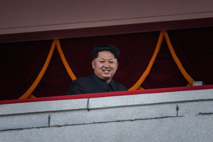 North Korea's leader Kim Jong-Un looks out towards Kim Il-Sung square during a mass military parade in Pyongyang on October 1