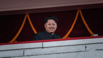 North Korea's leader Kim Jong-Un looks out towards Kim Il-Sung square during a mass military parade in Pyongyang on October 10, 2015. North Korea was marking the 70th anniversary of its ruling Workers' Party. AFP PHOTO / Ed Jones        (Photo credit should read ED JONES/AFP/Getty Images)