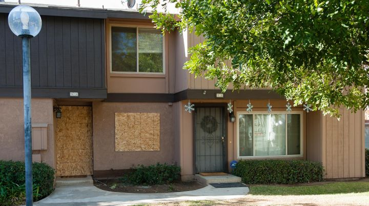 The rented Center Street townhouse of Syed Rizwan Farook and his wife, Tashfeen Malik, is boarded up as holiday decorations a