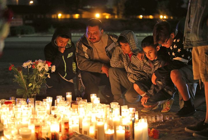 Mourners visit a makeshift memorial near the Inland Regional Center on December 4, 2015 in San Bernardino, California.