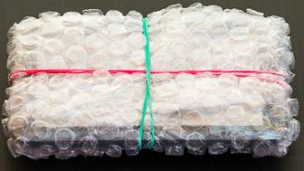 Packed and sealed electronic device in bubble wrap