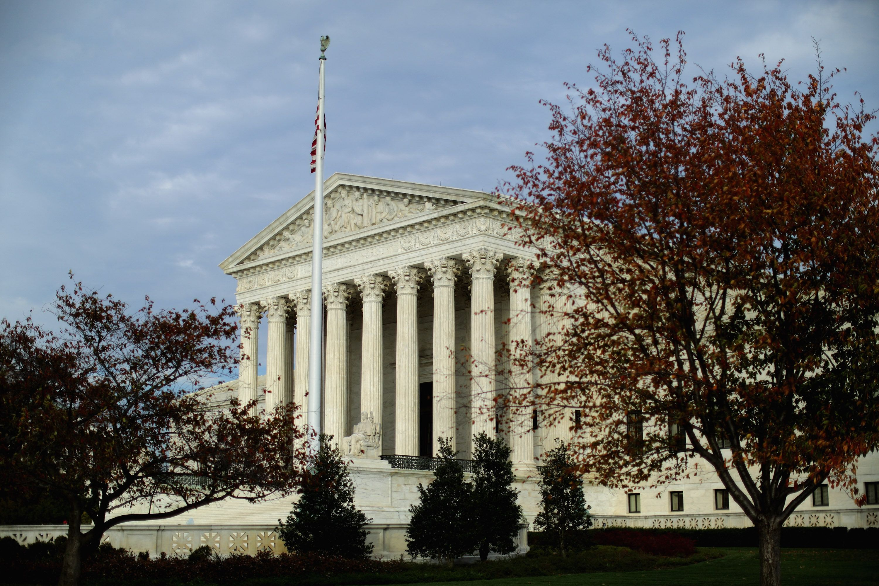 WASHINGTON, DC - NOVEMBER 06:  The United States Supreme Court building is framed by fall foliage November 6, 2015 in Washington, DC. The court announced Friday that it will hear another case related to the landmark Affordable Care Act, or Obamacare, and its contraception mandate as it relates to religious nonprofit groups.  (Photo by Chip Somodevilla/Getty Images)