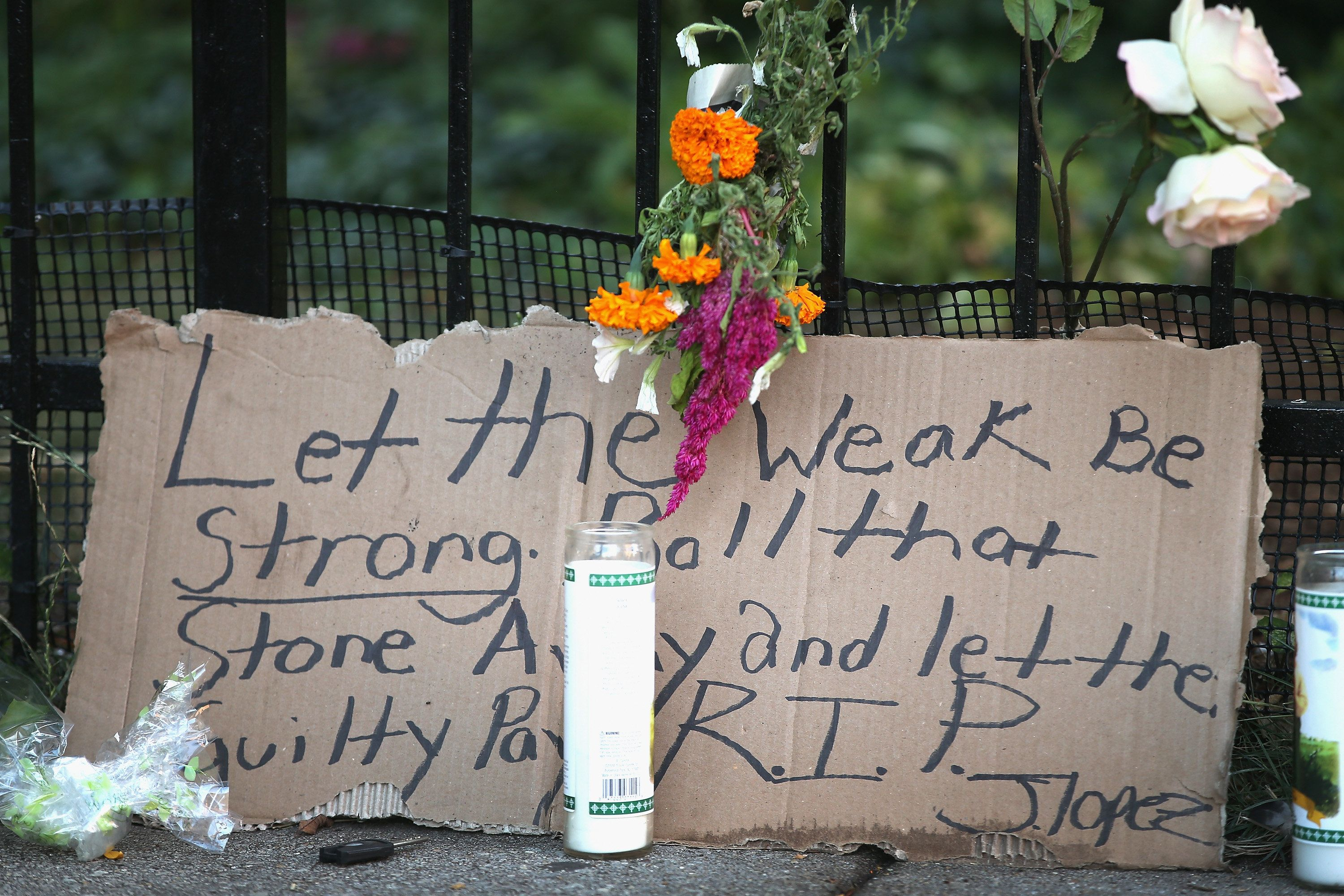 A memorial sits on the edge of the sidewalk outside the Uptown Baptist Church near where the victims of the shooting fel