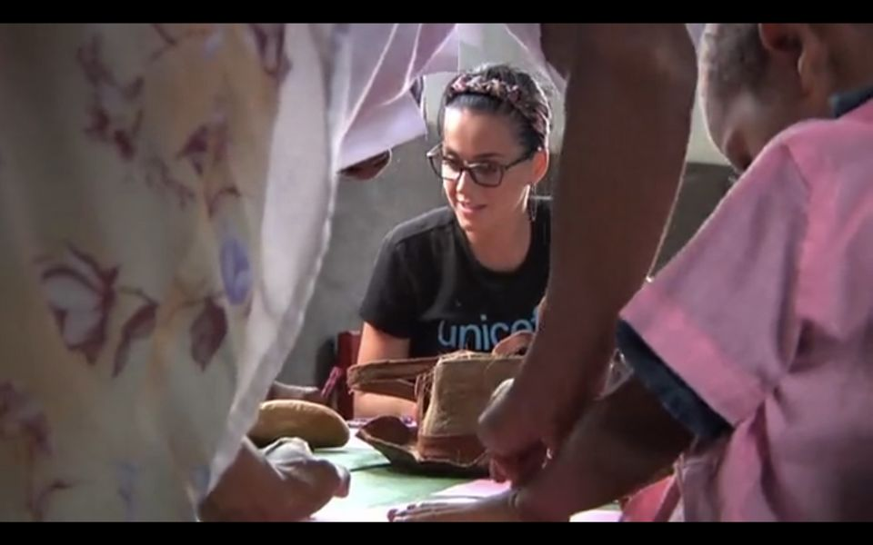 """The """"Dark Horse"""" singer is seen working with children attending Unicef programs in Madagascar back in 2013."""