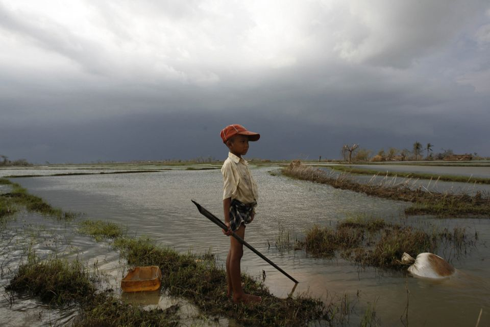 A boy whose house was destroyed by the cyclone watches an approaching storm, some 50 kilometres southwest of the township of