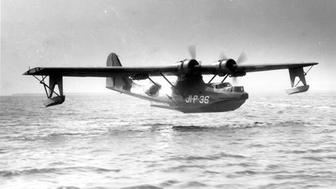 An example photo of a PBY-5, like the one discovered the UH's divers, making a landing.