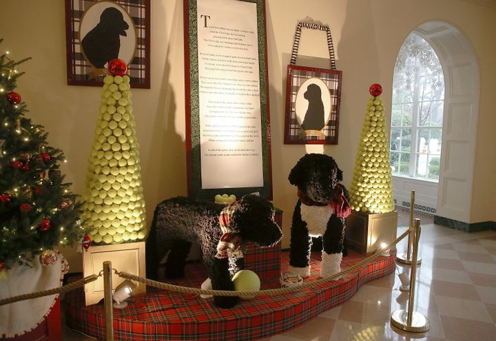 """A display of the Obama family dogs, Bo and Sunny, at the White House on Dec. 2, 2015. According to a White House press release, the replicas were """"created out of nearly 55,000 feet of yarn knitted into 7,000 yarn pom-poms."""""""