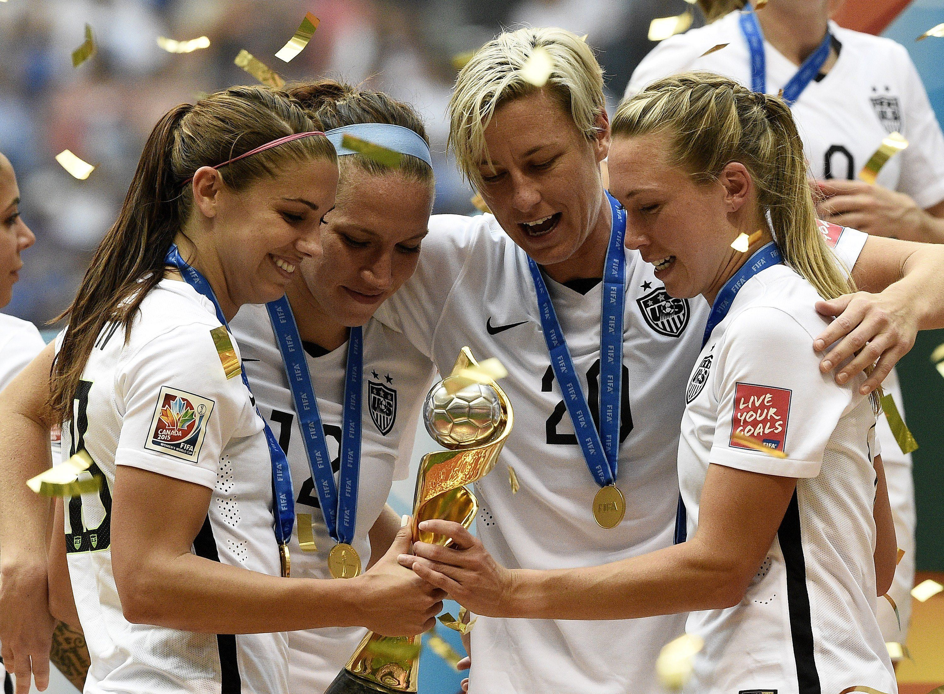 (L-R) USA's Alex Morgan, Lauren Holiday, Abby Wambach and Whitney Engen celebrate after winning the final 2015 FIFA Women's World Cup match between USA and Japan at the BC Place Stadium in Vancouver on July 5, 2015.  AFP PHOTO / FRANCK FIFE        (Photo credit should read FRANCK FIFE/AFP/Getty Images)