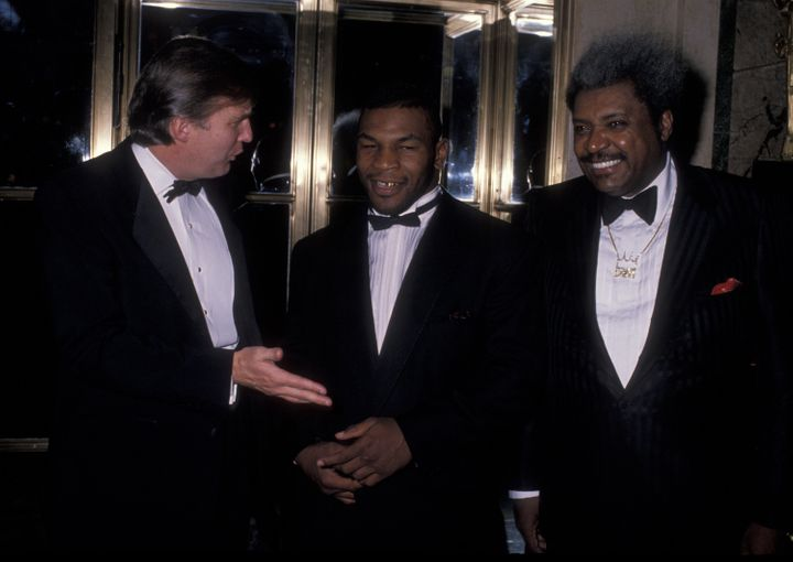 Donald Trump with boxer Mike Tyson (center) and promoter Don King at a charity gala in 1989.