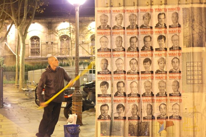 Avaaz's wanted posters go up in Paris during the COP21 conference.