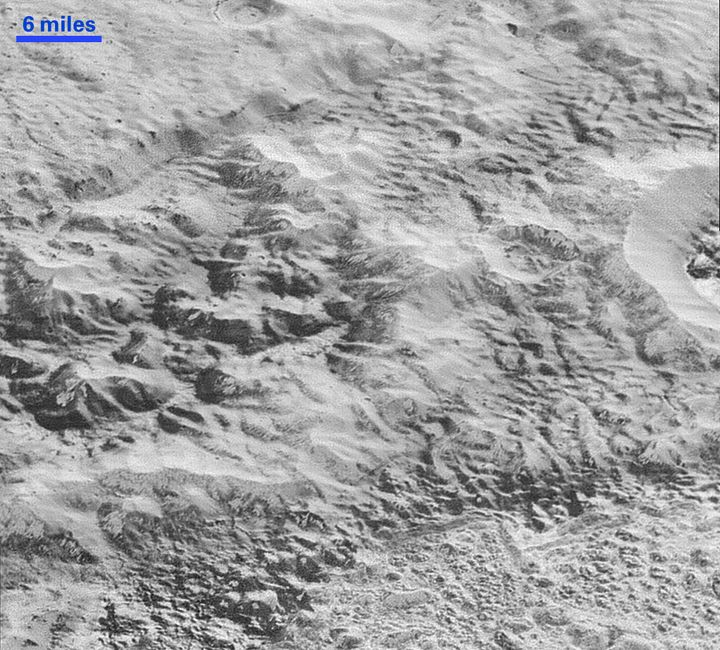 This imageshows how erosion and faulting have sculpted this portion of Pluto's icy crust into rugged badlands.