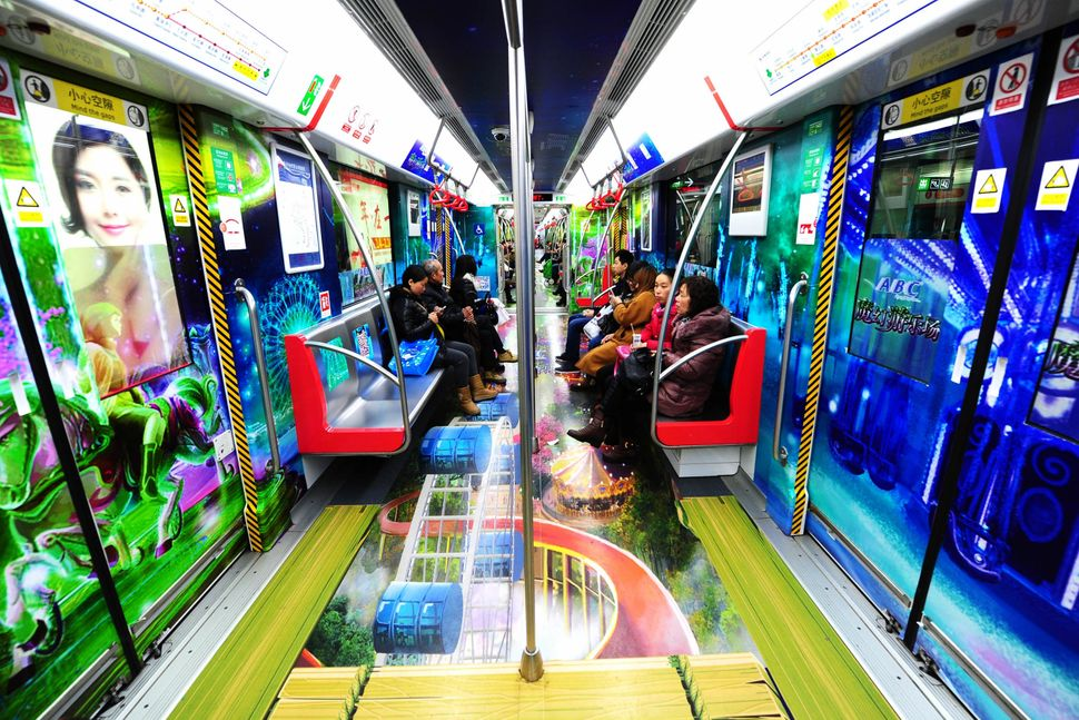 A healthy and happy themed subway train is seen on March 5, 2015, in Hangzhou, Zhejiang province of China. Hangzhou Metro is