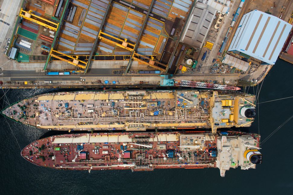 Liquefied natural gas (LNG) tankers stand under construction in this aerial photograph taken above the Hyundai Heavy Industri