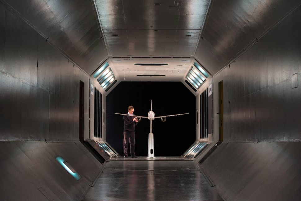 A scale model of a plane is prepared for testing in the Airbus Filton's low-speed wind tunnel facility at the Airbus aircraft