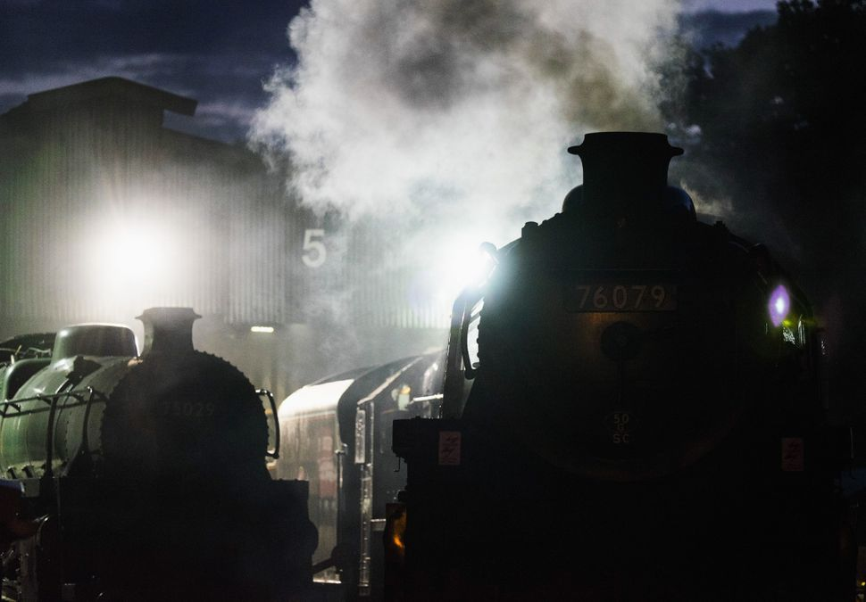 Steam locomotives sit at sidings as maintenance is carried out in the Grosmont railway sheds at the North Yorkshire Moors Rai