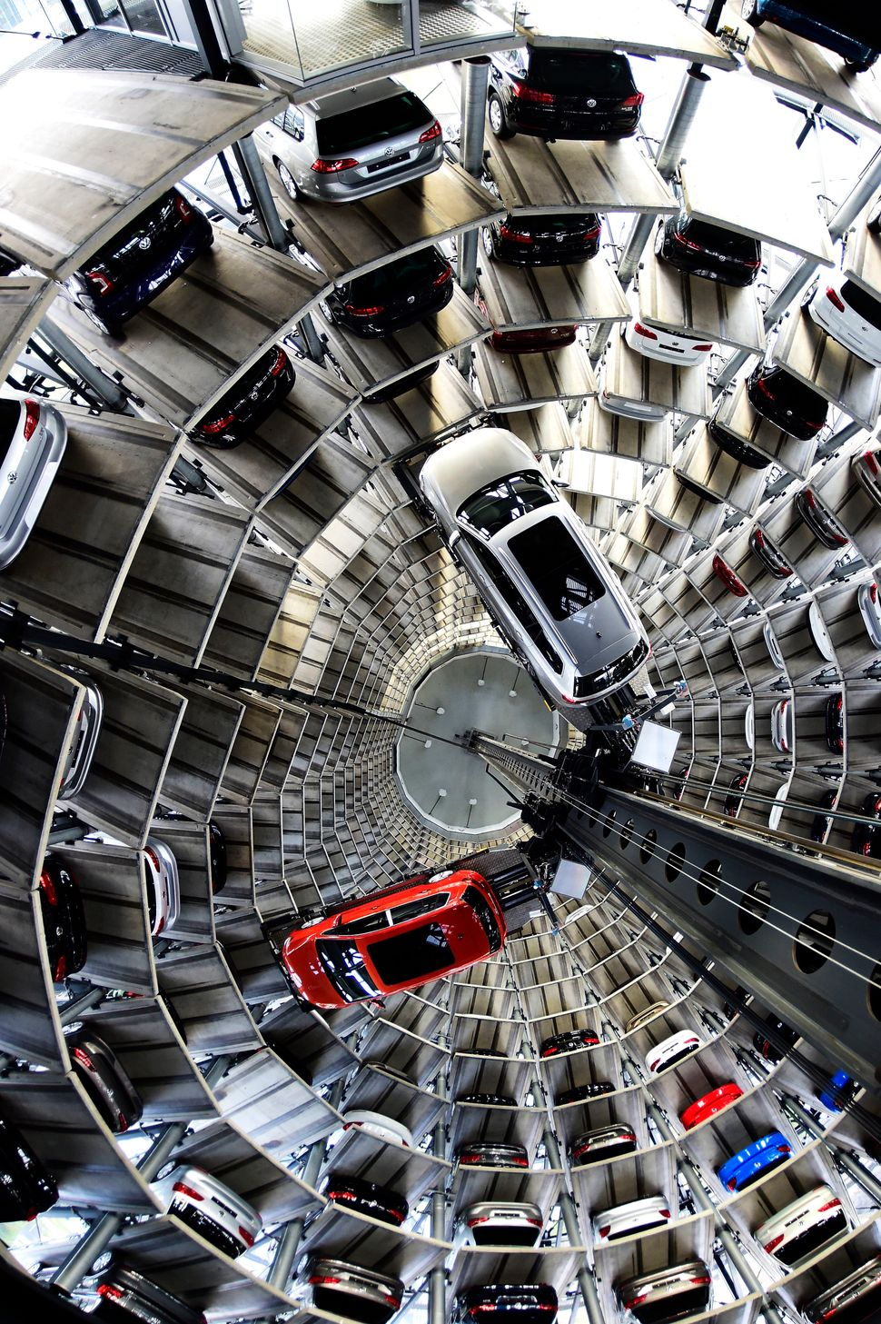 A brand new Volkswagen Passat and a Golf 7 car are stored in a tower at the Volkswagen Autostadt complex near the Volkswagen