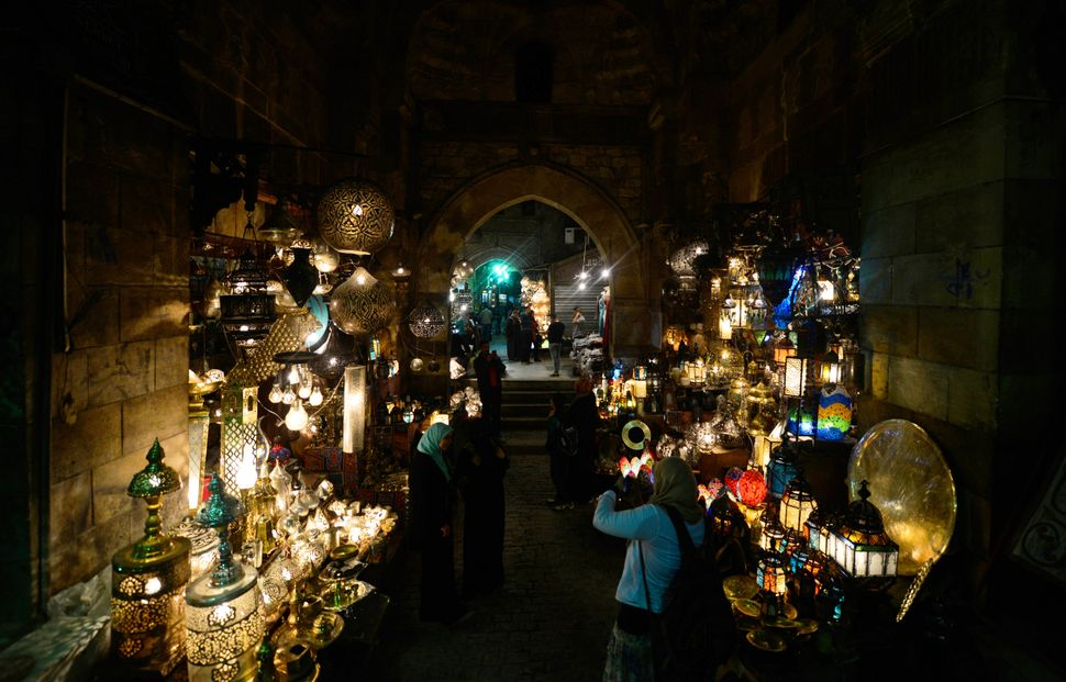 People walk past shops in al-Moez street in Cairo's Khan el-Khalili district, in Egypt on March 7, 2015. Al-Moez street is on