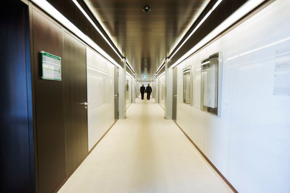 Offices line a corridor inside the Bundesbank, Germany's central bank, in Frankfurt, Germany, on Tuesday, Sept. 29, 2015. Ger