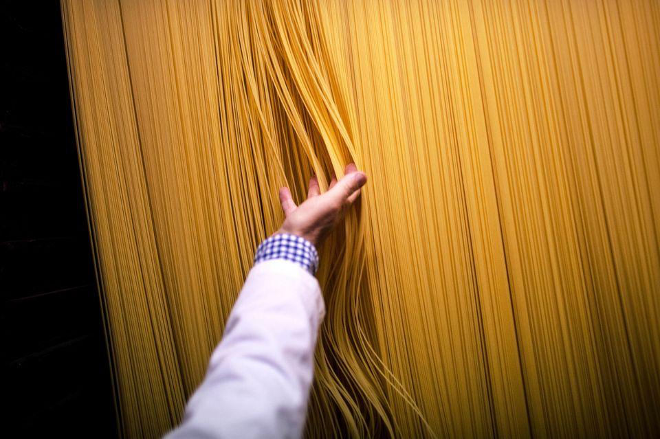 Carles Sanmarti checks noodles drying in wood cabinets at Pasta Sanmarti factory on Oct. 27, 2015, in Caldes de Montbui, Spai