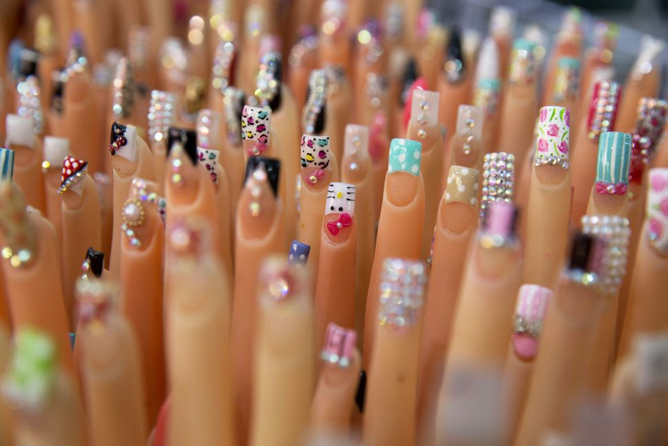 Mannequin hands display different types of nail art at the Atarazanas beauty mall center in Mexico City, Mexico, on Thursday,